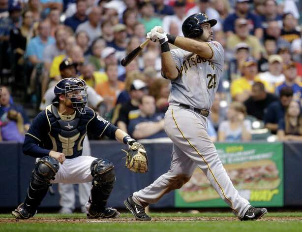 Pittsburgh Pirates' Pedro Alvarez watches his three-run home run during the fourth inning of a baseball game against the Milwaukee Brewers on Saturday, Aug. 23, 2014, in Milwaukee. (AP Photo/Morry Gash) ORG XMIT: WIMG107 Photo: Morry Gash / AP