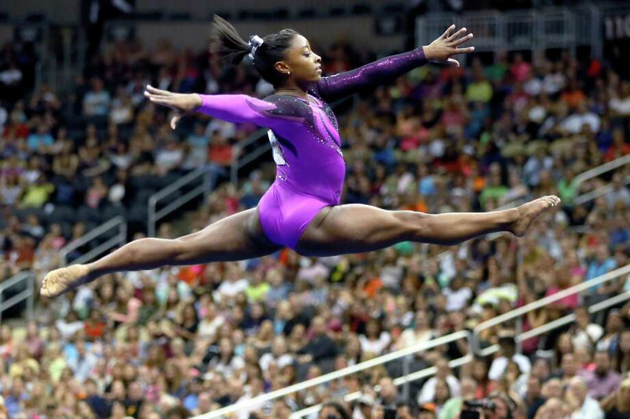 Simone Biles of Spring performs in the floor exercise portion of the competition in the USA Gymnastics championships Saturday in Pittsburgh. Biles beat Olympic gold medalist Kyla Ross by 4.25 points for the all-around crown. Photo: Keith Srakocic, STF / AP