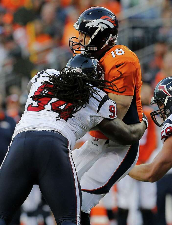 Denver Broncos quarterback Peyton Manning (18) is sacked by Houston Texans defensive tackle Ricardo Mathews during an NFL preseason football game, Saturday, Aug. 23, 2014, in Denver. (AP Photo/Joe Mahoney) Photo: Joe Mahoney, Associated Press / FR170363 AP
