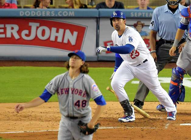 Los Angeles Dodgers' Adrian Gonzalez and New York Mets starting pitcher Jacob deGrom watch Gonzalez's three-run home run during the fifth inning of a baseball game, Saturday, Aug. 23, 2014, in Los Angeles. (AP Photo/Mark J. Terrill) ORG XMIT: LAD120 Photo: Mark J. Terrill / AP