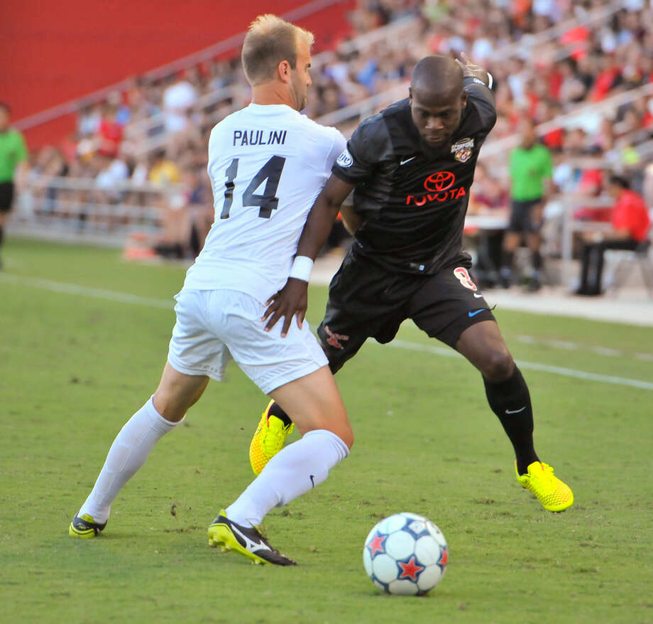 Billy Forbes (right) of the Scorpions works to get around Atlanta's Lucas Paulini on Saturday. The Scorpions are unbeaten in their last seven matches at Toyota Field. Photo: Robin Jerstad / For The Express-News