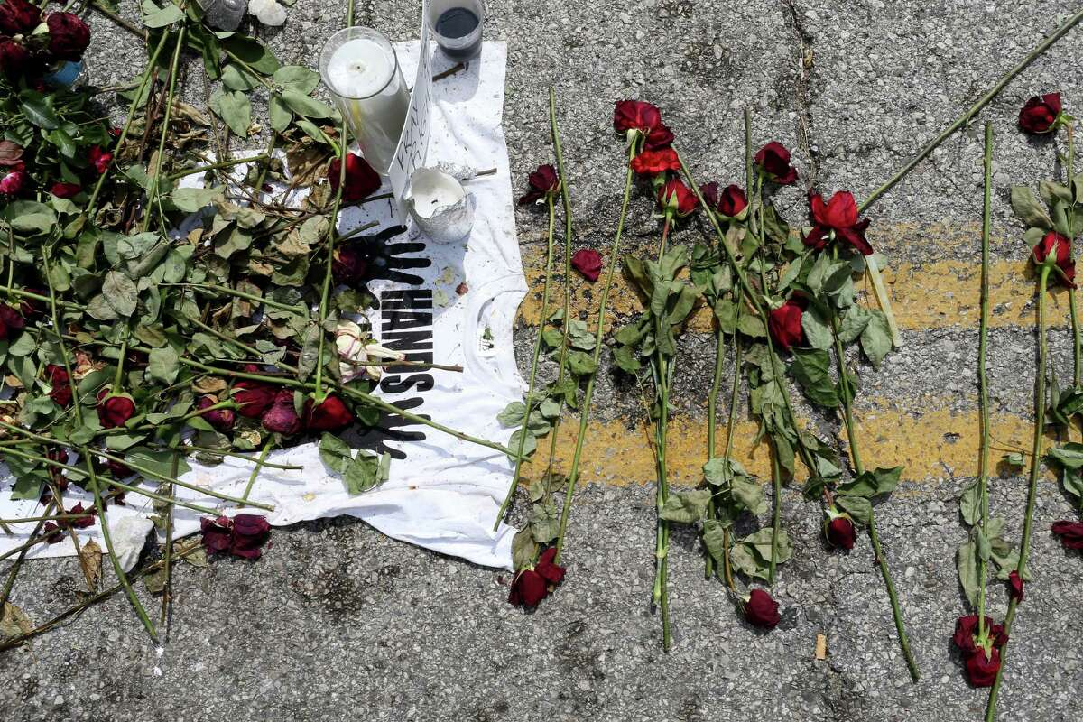 FERGUSON, MO - AUGUST 22: Roses are seen in a memorial setup for Michael Brown on the spot where his body lay after he was shot by police on August 22, 2014 in Ferguson, Missouri. Protesters have been vocal asking for justice in the shooting death of Michael Brown by a Ferguson police officer on August 9th.