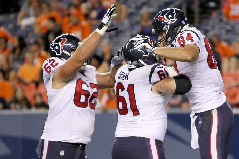 Texans tight end Ryan Griffin (84) celebrates with linemen Matt Paradis (61) and Alex Kupper (62) after scoring on a 31-yard touchdown pass with :59 left to play. Photo: Brett Coomer, Houston Chronicle