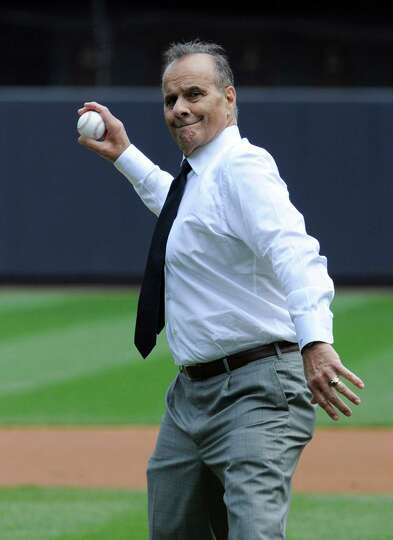 Former New York Yankees manager Joe Torre throws out the first pitch Saturday at Yankee Stadium.