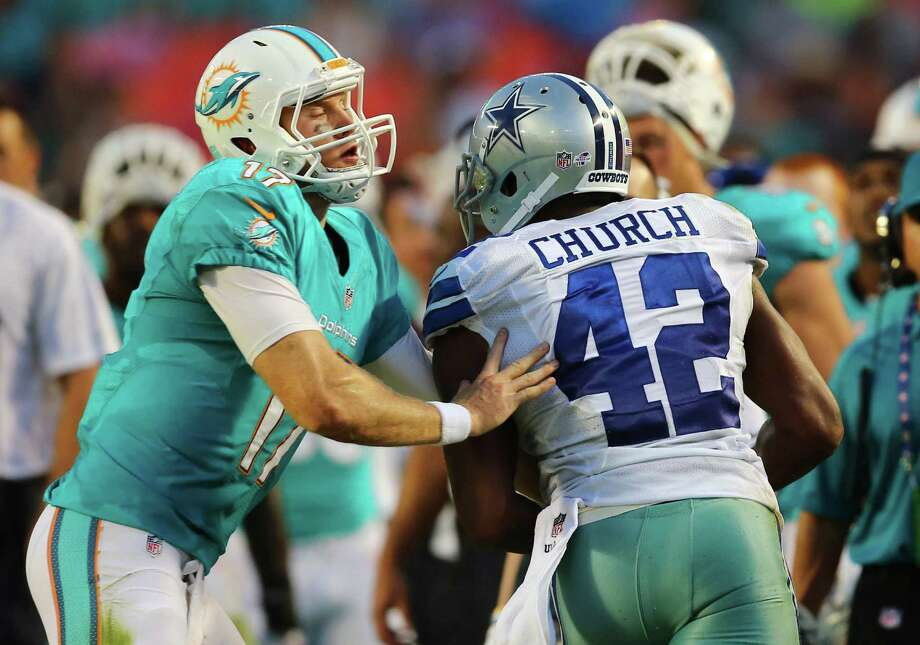 Dolphins QB Ryan Tannehill (left) tries to tackle the Cowboys' Barry Church after the free safety recovered a fumble. Photo: J. Pat Carter / Associated Press / AP