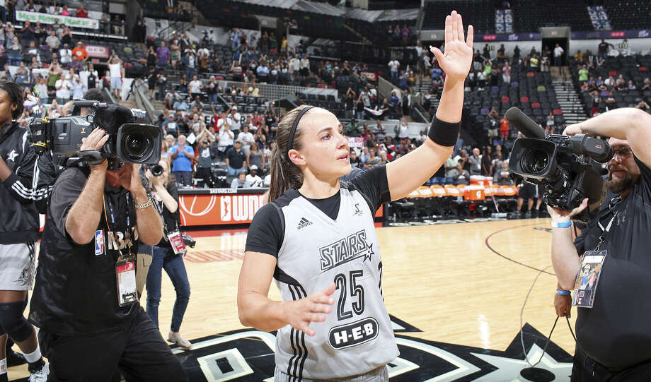 Becky Hammon bids an emotional farewell to fans at the AT&T Center after the Lynx eliminated the Stars. Hammon will now focus on becoming an assistant coach for the Spurs. Photo: Edward A. Ornelas, San Antonio Express-News / © 2014 San Antonio Express-News