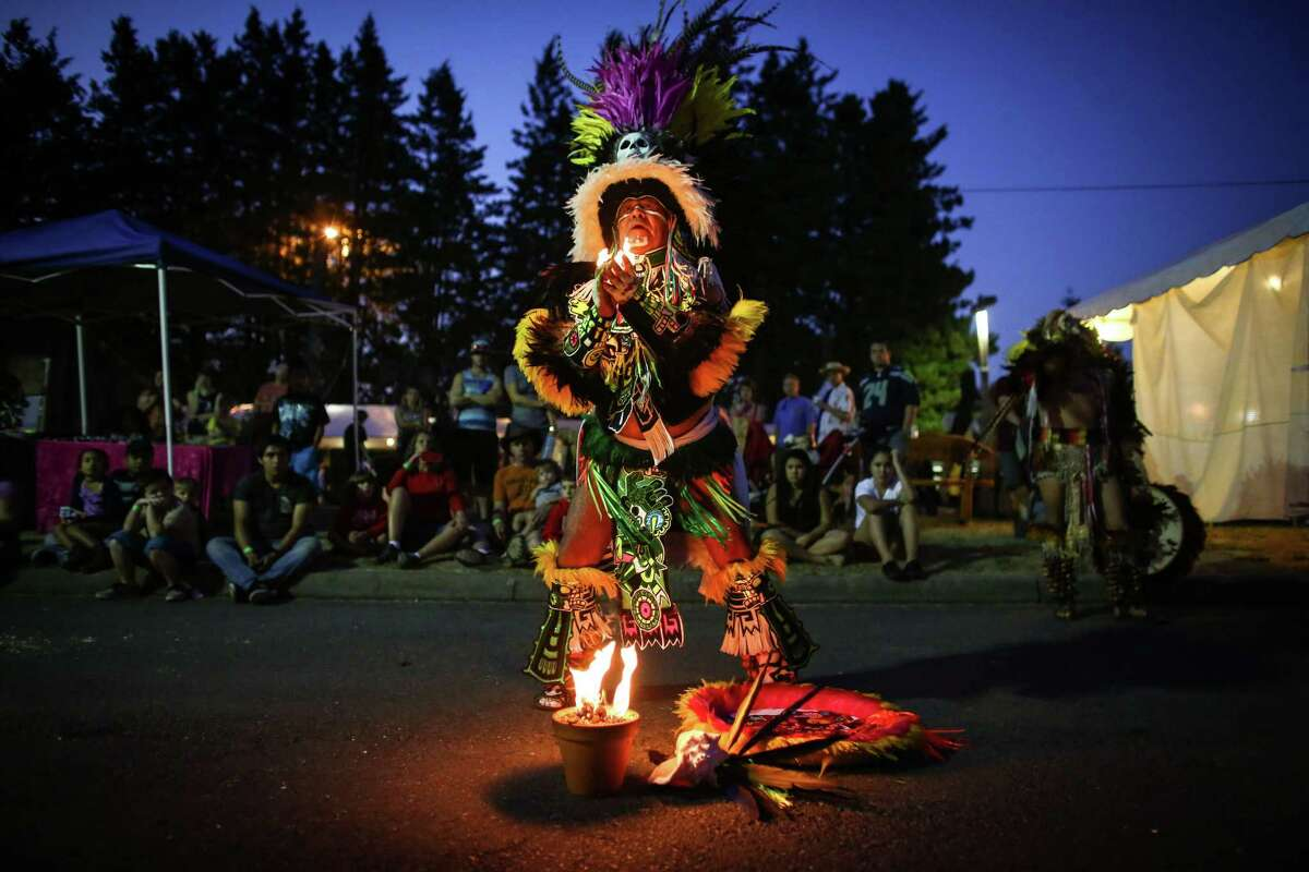 Aztec dancers from the group Tlokenahuake perform during the first weekend of the Evergreen State Fair in Monroe. The annual fair continues through September 1. Photographed on Saturday, August 23, 2014.