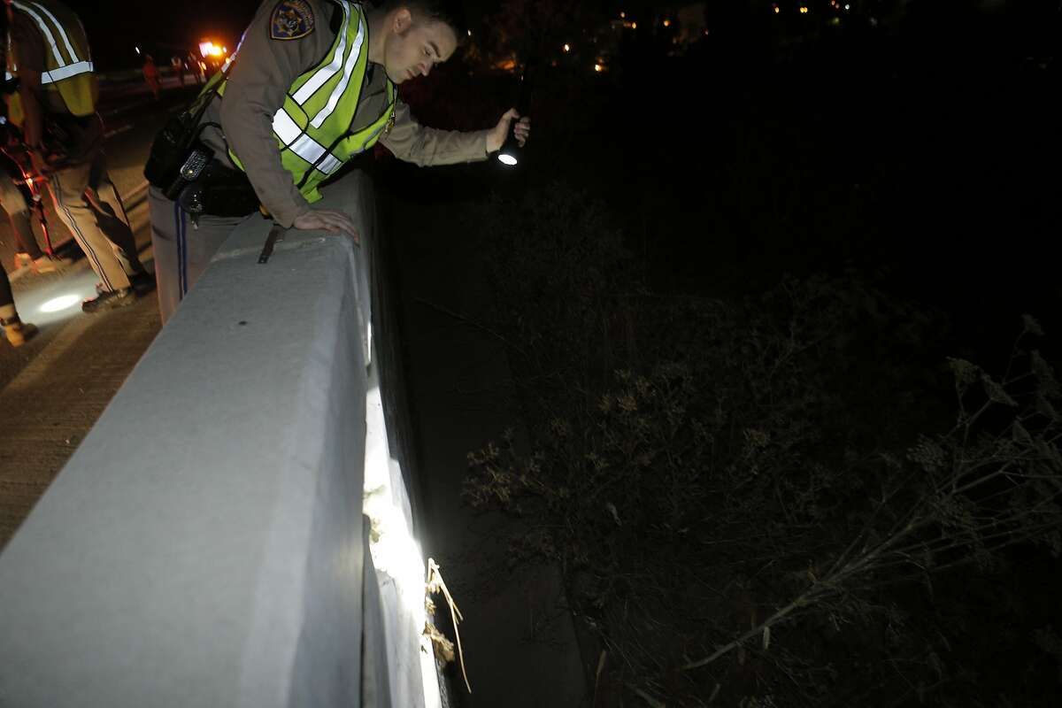 A CHP officer checks the offramp from Highway 37 to Sonoma Blvd. that was damaged as a strong earthquake hit the San Francisco Bay Area centered near American Canyon, Calif., on Sunday, August 24, 2014.
