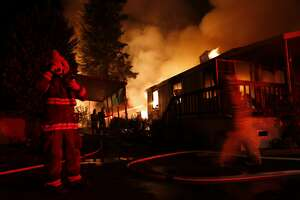 Napa Firefighters work on extinguishing in mobile home park in Napa, Calif. on Sunday, August 24, 2014,