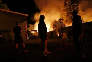 A fire burns in a mobile home park in Napa, Calif. after an earthquake on Sunday, August 24, 2014,