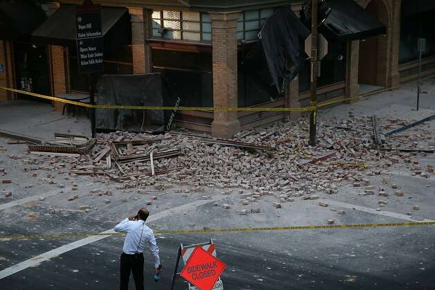 A reporter surveys the scene of a building collapse following a reported 6.0 earthquake on August 24, 2014 in Napa, California. Photo: Justin Sullivan, Getty Images