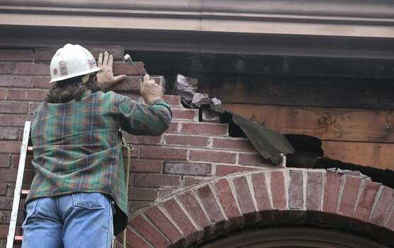 Mike McGinnis removes a loose section of brick after part of a wall fell from the First United Methodist Church on Sonoma Boulevard in Vallejo, Calif. on Sunday, Aug. 24, 2014 after a 6.0 earthquake jolted the Bay Area. Photo: Paul Chinn, The Chronicle