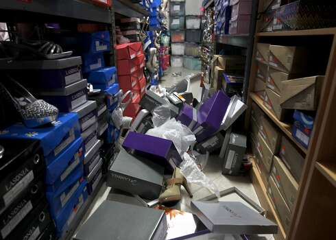Boxes of dress shoes lie on the aisle of Alexis Jewlery and gown shop on Tennessee Street in Vallejo, Calif. on Sunday, Aug. 24, 2014 after a 6.0 earthquake jolted the Bay Area. Photo: Paul Chinn, The Chronicle