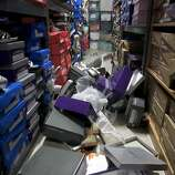 Boxes of dress shoes lie on the aisle of Alexis Jewlery and gown shop on Tennessee Street in Vallejo, Calif. on Sunday, Aug. 24, 2014 after a 6.0 earthquake jolted the Bay Area.