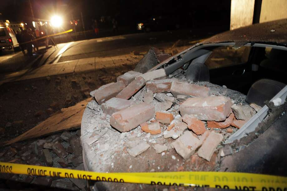 A car in downtown Napa shows damage from Sunday's earthquake. Photo: Carlos Avila Gonzalez, The Chronicle