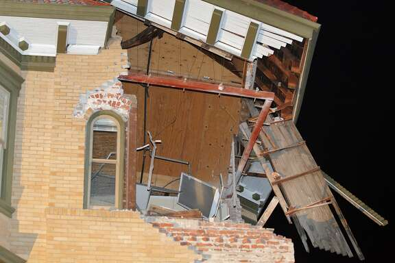 The facade of a building at Second and Brown Streets in Napa, Calif., shows severe damage after a strong earthquake hit the San Francisco Bay Area centered near American Canyon, on Sunday, August 24, 2014.