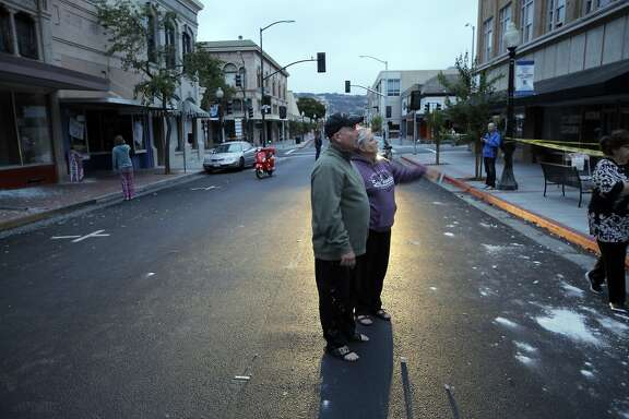 Bud and Annie Reeves, look over damage from an earthquake in Napa, Calif., as a strong earthquake hit the San Francisco Bay Area centered near American Canyon522298, on Sunday, August 24, 2014.