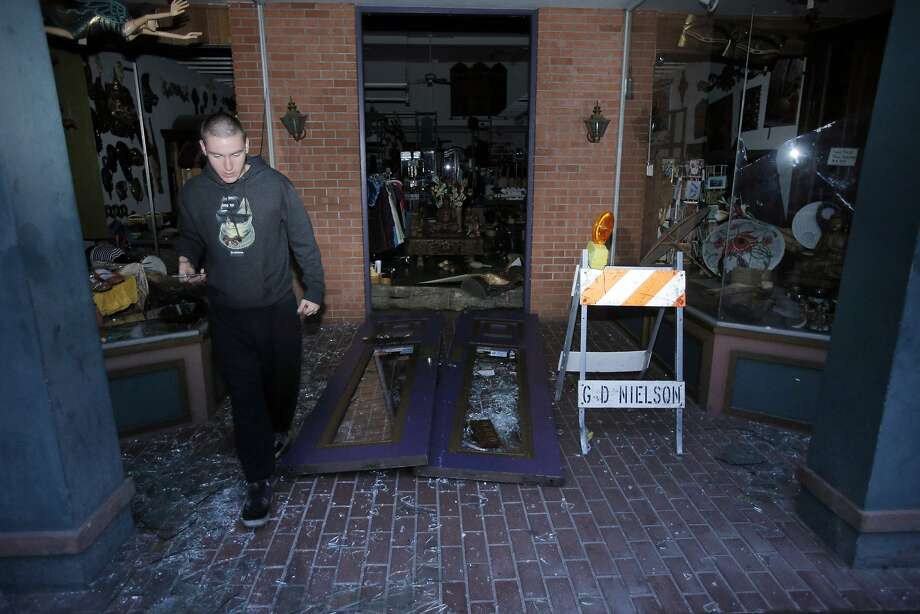 Justen Johnson looks over damage to a store in downtown Napa, Calif., as a strong earthquake hit the San Francisco Bay Area centered near American Canyon522298, on Sunday, August 24, 2014. Photo: Carlos Avila Gonzalez, The Chronicle