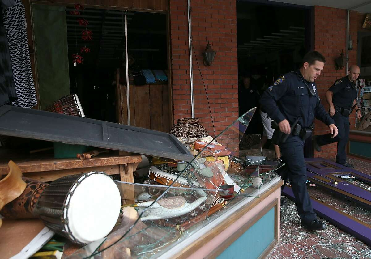 NAPA, CA - AUGUST 24: Police officers exit a damaged buillding following a reported 6.0 earthquake on August 24, 2014 in Napa, California. A 6.0 earthquake rocked the San Francisco Bay Area shortly after 3:00 am on Sunday morning causing damage to buildings and sending at least 70 people to a hospital with non-life threatening injuries. (Photo by Justin Sullivan/Getty Images)
