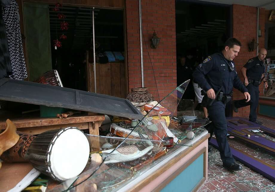 NAPA, CA - AUGUST 24:  Police officers exit a damaged buillding following a reported 6.0 earthquake on August 24, 2014 in Napa, California.  A 6.0 earthquake rocked the San Francisco Bay Area shortly after 3:00 am on Sunday morning causing damage to buildings and sending at least 70 people to a hospital with non-life threatening injuries.  (Photo by Justin Sullivan/Getty Images) Photo: Justin Sullivan, Getty Images