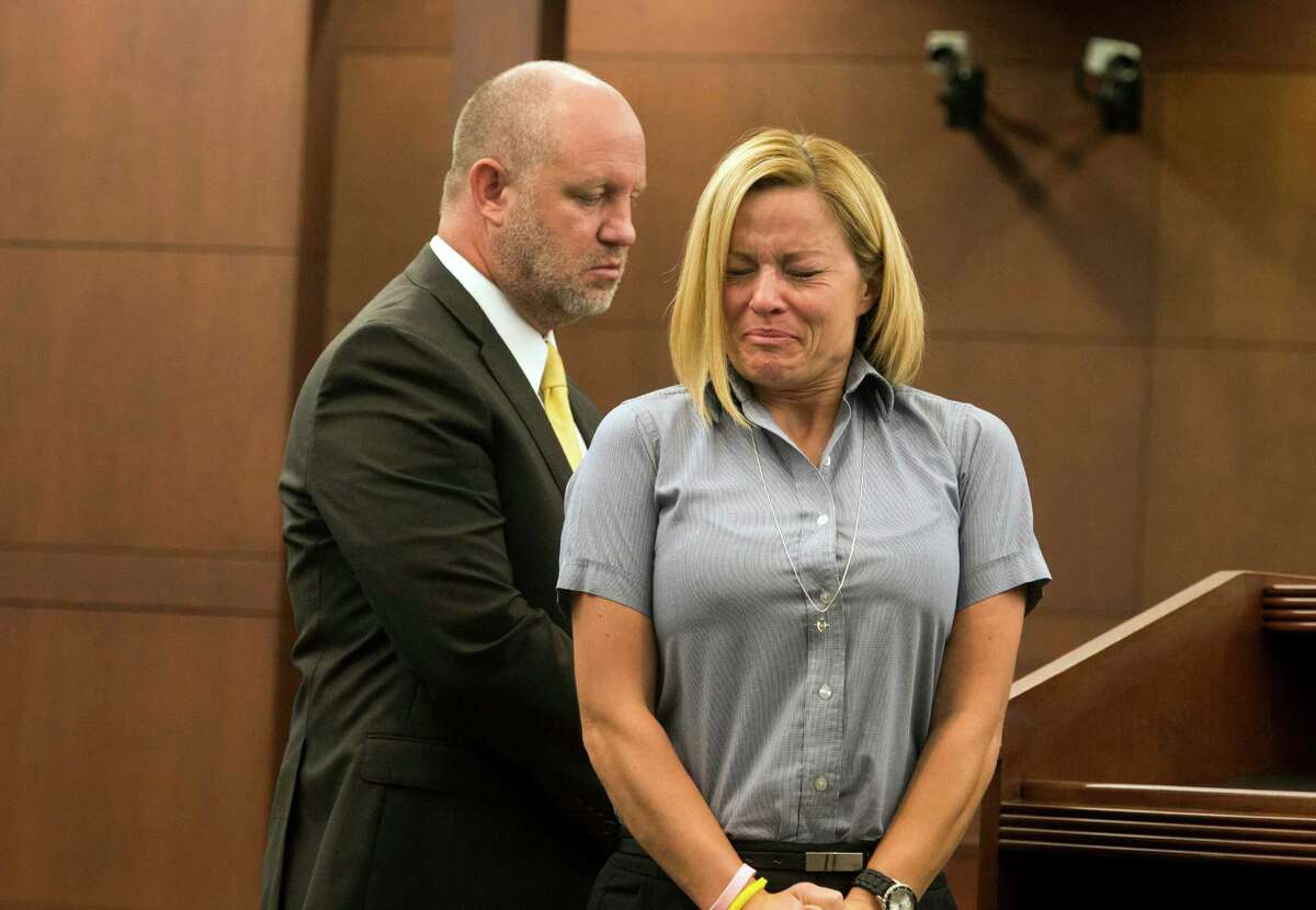 Dea Millerberg, convicted of helping her husband dump their teenage baby sitter's body in the woods after a night of sex and drugs, makes a statement during her sentencing hearing Thursday, Aug. 21, 2014, in Ogden, Utah. Millerberg, who pleaded guilty in June to three felonies, including desecration of a human body, was sentenced to prison for up to five years. Attorney Michael D. Bouwhuis is on the left.