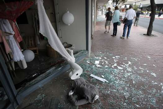 A mannequin lies on the sidewalks after it fell through a store window on First Street in Napa, Calif., after a strong earthquake hit the San Francisco Bay Area centered near American Canyon, on Sunday, August 24, 2014. Photo: Carlos Avila Gonzalez, The Chronicle