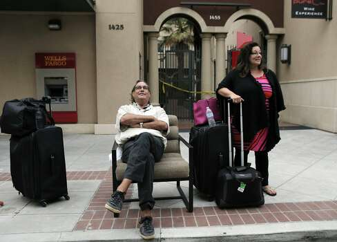 Larry Helmle and his wife Jeri of Yorba Linda, wait outside the Andaz Napa Hotel in Napa, Calif., after they were evacuated following a strong earthquake hit the San Francisco Bay Area centered near American Canyon, on Sunday, August 24, 2014. Photo: Carlos Avila Gonzalez, The Chronicle