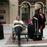 Larry Helmle and his wife Jeri of Yorba Linda, wait outside the Andaz Napa Hotel in Napa, Calif., after they were evacuated following a strong earthquake hit the San Francisco Bay Area centered near American Canyon, on Sunday, August 24, 2014.