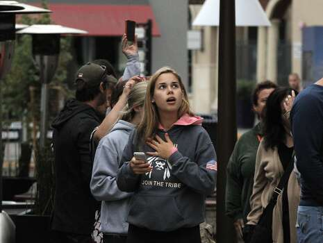 Grace Bartlett reacts to damage and flooding near the McCaulou's department store in Napa, Calif., after a strong earthquake hit the San Francisco Bay Area centered near American Canyon, on Sunday, August 24, 2014. Photo: Carlos Avila Gonzalez, The Chronicle