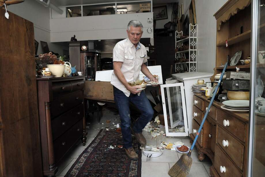 Peter Ross cleans up his store, Antique Shoppe, in Napa, Calif., after a strong earthquake hit the San Francisco Bay Area centered near American Canyon, on Sunday, August 24, 2014. Photo: Carlos Avila Gonzalez, The Chronicle