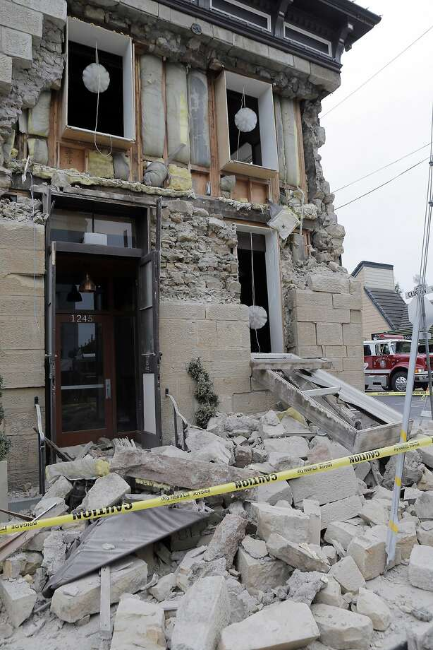 The Vintner's Collective on Main Street in Napa sustained major damage to its facade, but the owner says there was little damage inside. Requirements for reinforcing masonry structures vary city to city. Photo: Carlos Avila Gonzalez, The Chronicle