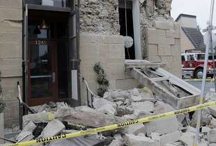 Vintner's Collective on Main Street in Napa, Calif., sustained major damage to its facade, but little inside damage according to the owner after a strong earthquake hit the San Francisco Bay Area centered near American Canyon, on Sunday, August 24, 2014.