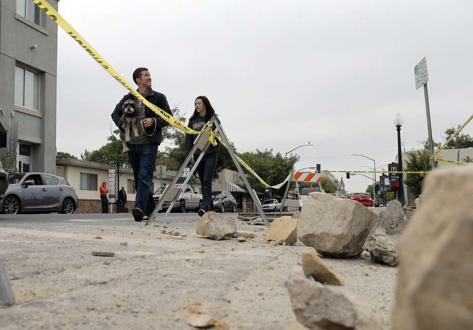 Mike Kerr and Jennifer Marley walk past the damage to Vintners Collective in Napa, Calif., after a strong earthquake hit the San Francisco Bay Area centered near American Canyon, on Sunday, August 24, 2014. Photo: Carlos Avila Gonzalez, The Chronicle
