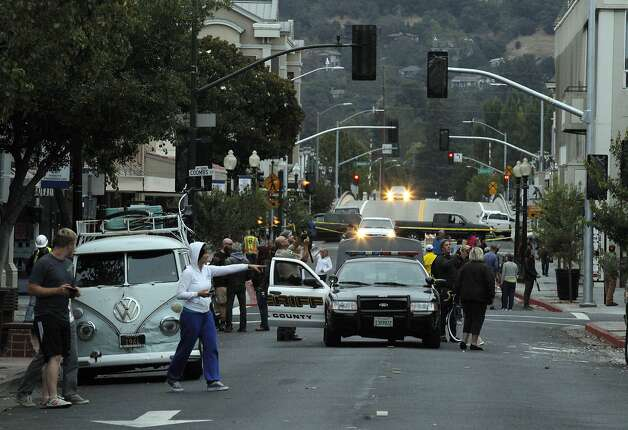 Police and residents survey the damage on First Street in Napa, Calif., as the morning light revealed the extent of damage after a strong earthquake hit the San Francisco Bay Area centered near American Canyon, on Sunday, August 24, 2014. Photo: Carlos Avila Gonzalez, The Chronicle