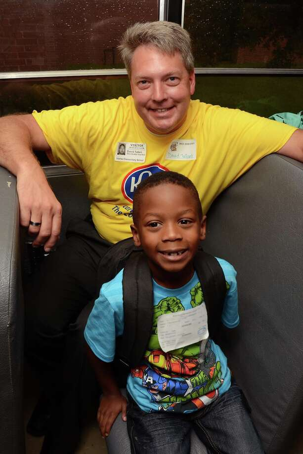 David Tallant rides the bus with Horne Elementary pupil. Photo: CFISD