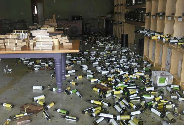 Bottles of olive oil and balsamic vinegar cover the floor of the Lucero Olive Oil store in Napa, Calif. on Sunday, Aug. 24, 2014 after a 6.0 earthquake jolted the Bay Area. Photo: Paul Chinn, The Chronicle