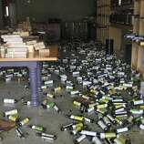 Bottles of olive oil and balsamic vinegar cover the floor of the Lucero Olive Oil store in Napa, Calif. on Sunday, Aug. 24, 2014 after a 6.0 earthquake jolted the Bay Area.