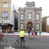 Curious onlookers view the damage to the historic Goodman Library in Napa, Calif. on Sunday, Aug. 24, 2014 after a 6.0 earthquake jolted the Bay Area.