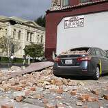 A car was heavily damaged by falling bricks in Napa, Calif. on Sunday, Aug. 24, 2014 after a 6.0 earthquake jolted the Bay Area.