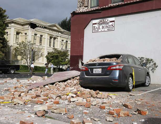 A car was heavily damaged by falling bricks in Napa, Calif. on Sunday, Aug. 24, 2014 after a 6.0 earthquake jolted the Bay Area. Photo: Paul Chinn, The Chronicle