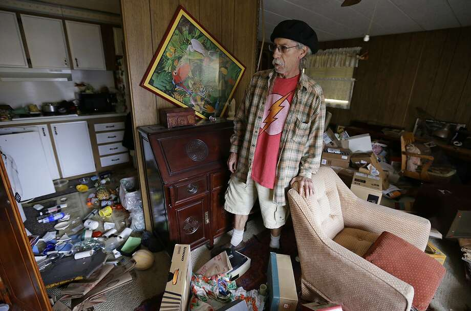Steve Brody inspects damage to the interior of his mobile home after am earthquake Sunday, Aug. 24, 2014, at the Napa Valley Mobile Home Park, in Napa, Calif. A large earthquake caused significant damage and left at least three critically injured in California's northern Bay Area early Sunday, igniting fires, sending at least 87 people to a hospital, knocking out power to tens of thousands and sending residents running out of their homes in the darkness.  Photo: Ben Margot, Associated Press