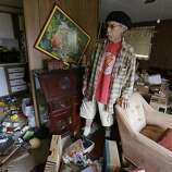 Steve Brody inspects damage to the interior of his mobile home after am earthquake Sunday, Aug. 24, 2014, at the Napa Valley Mobile Home Park, in Napa, Calif. A large earthquake caused significant damage and left at least three critically injured in California's northern Bay Area early Sunday, igniting fires, sending at least 87 people to a hospital, knocking out power to tens of thousands and sending residents running out of their homes in the darkness.