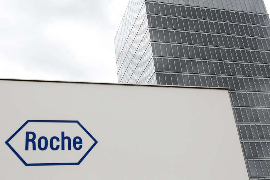 FILE - In this June 6, 2011 file picture, the logo of Swiss drugmaker Roche is photographed in Rotkreuz, Switzerland. Roche Holding AG .  Swiss pharmaceutical company Roche says it will buy InterMune, Inc., a California-based developer of treatments for lung diseases, in a deal worth US $8.3 billion. Roche said SundayAug. 24, 2014  the companies have reached an agreement under which Roche will acquire InterMune in an all-cash transaction, with Roche paying US$ 74.00 per InterMune share. That's a premium of 38 percent over InterMune's closing price on Friday.  (AP Photo/Keystone/Urs Flueeler, File) Photo: Urs Flueeler, Associated Press
