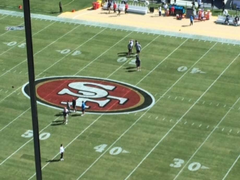 The temporary turf installed by the 49ers before Sunday's preseason game against the Chargers looks patchy with visible seams. (Al Saracevic/SF Chronicle)