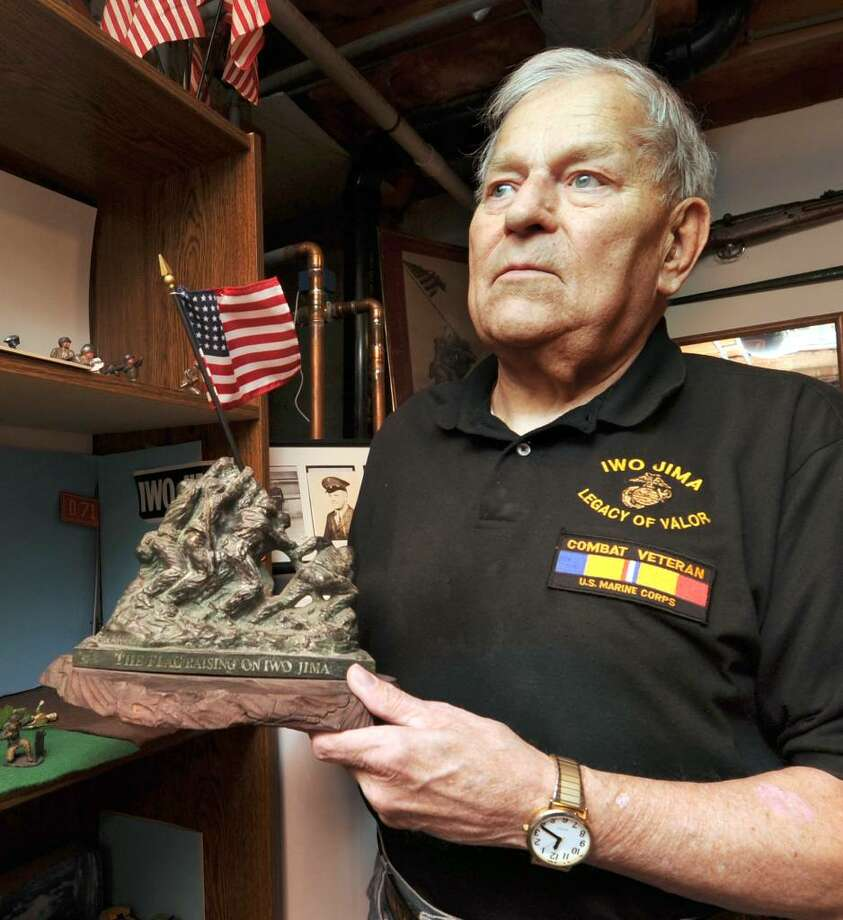 Emil Samuelson of Danbury, a World War ll veteran who was at the Battle of Iwo Jima, with some of the memorabilia that he keeps in his home. Photo: Carol Kaliff / The News-Times