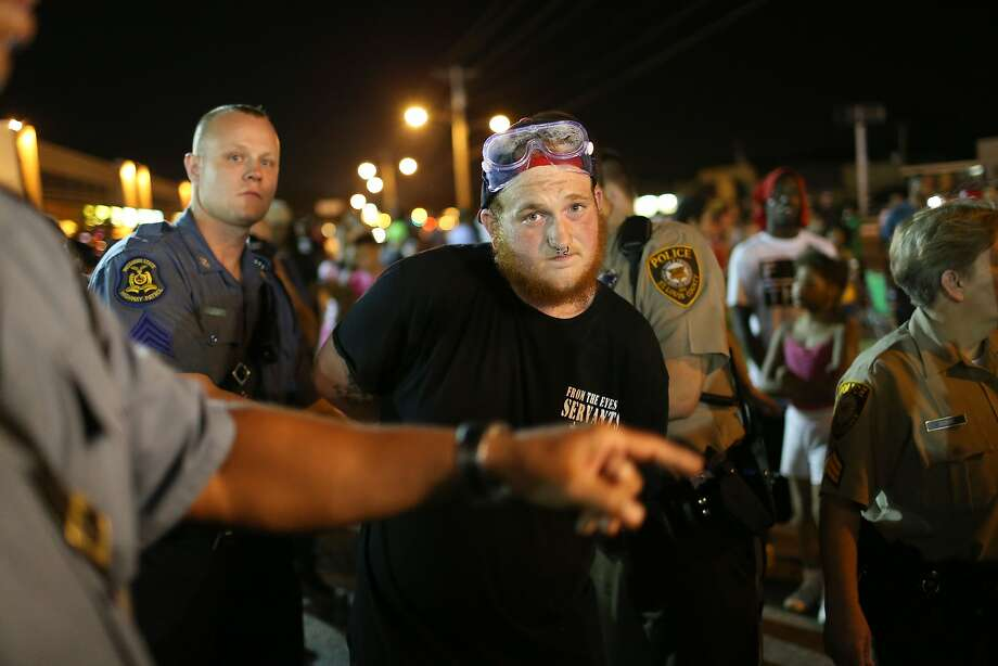 A protester is arrested at a Saturday rally over the shooting death of Michael Brown in Ferguson, Mo. Photo: Joe Raedle, Getty Images
