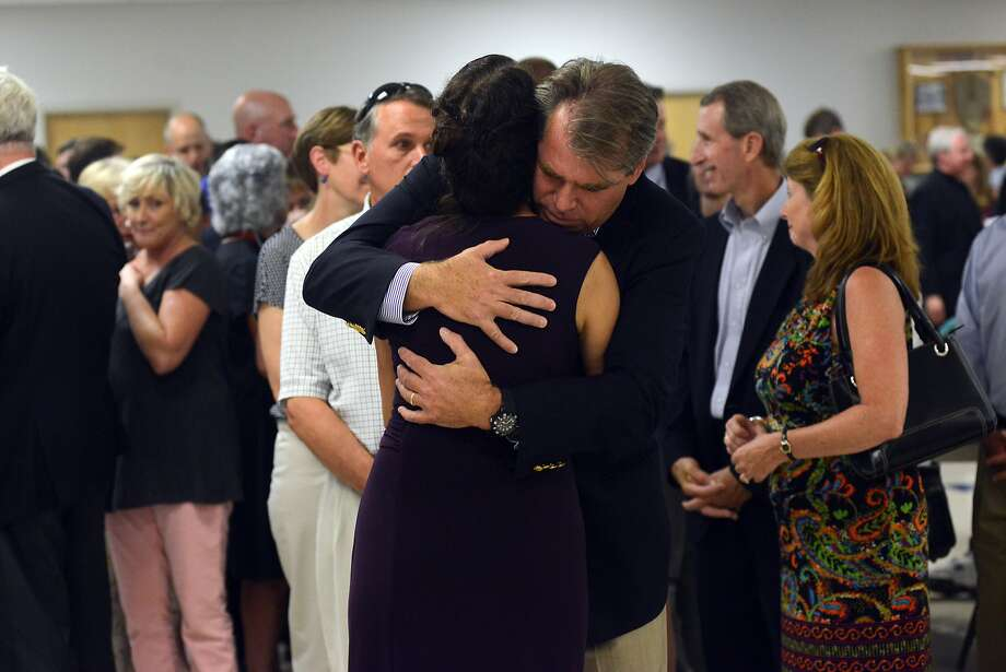 Diane Foley receives a hug after a Mass in Rochester, N.H., to remember her son, photographer James Foley, who was executed by Islamic State militants. Photo: Darren McCollester, Getty Images