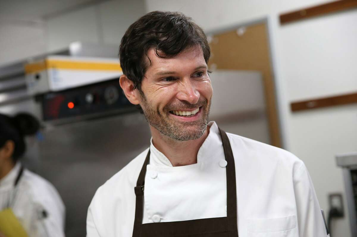Chef Daniel Patterson of Coi works in the kitchen while participating in the James Beard Foundation's Taste America benefit dinner at the St. Regis in San Francisco, Calif., on Friday, October 4, 2013.