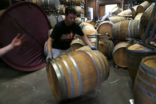Kevin Kyle of Saintsbury Winery removes barrels tossed about during the quake. Most of them were empty, but the facility's water tank jumped its foundation. Photo: Scott Strazzante, The Chronicle