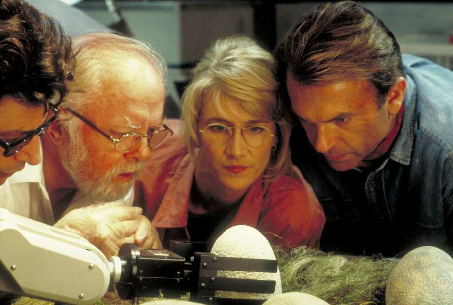 From left to right, actors Jeff Goldblum as Dr. Ian Malcolm, Richard Attenborough as John Hammond, Laura Dern as Dr. Ellie Sattler and Sam Neill as Dr. Alan Grant, watching a robotic arm handle the dinosaur eggs in a scene from the film 'Jurassic Park', 1993. Photo: Murray Close, Getty Images / 2011 Murray Close
